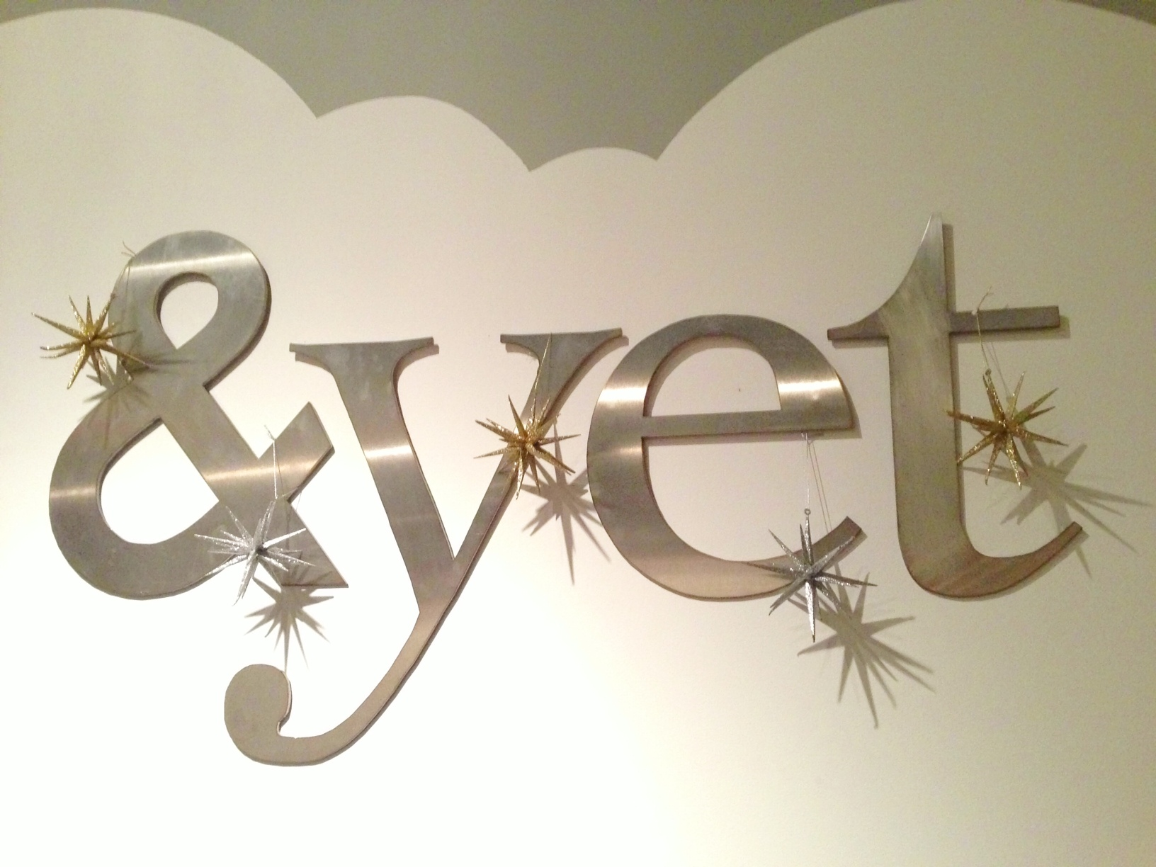 the &yet office logo decorated with ornaments