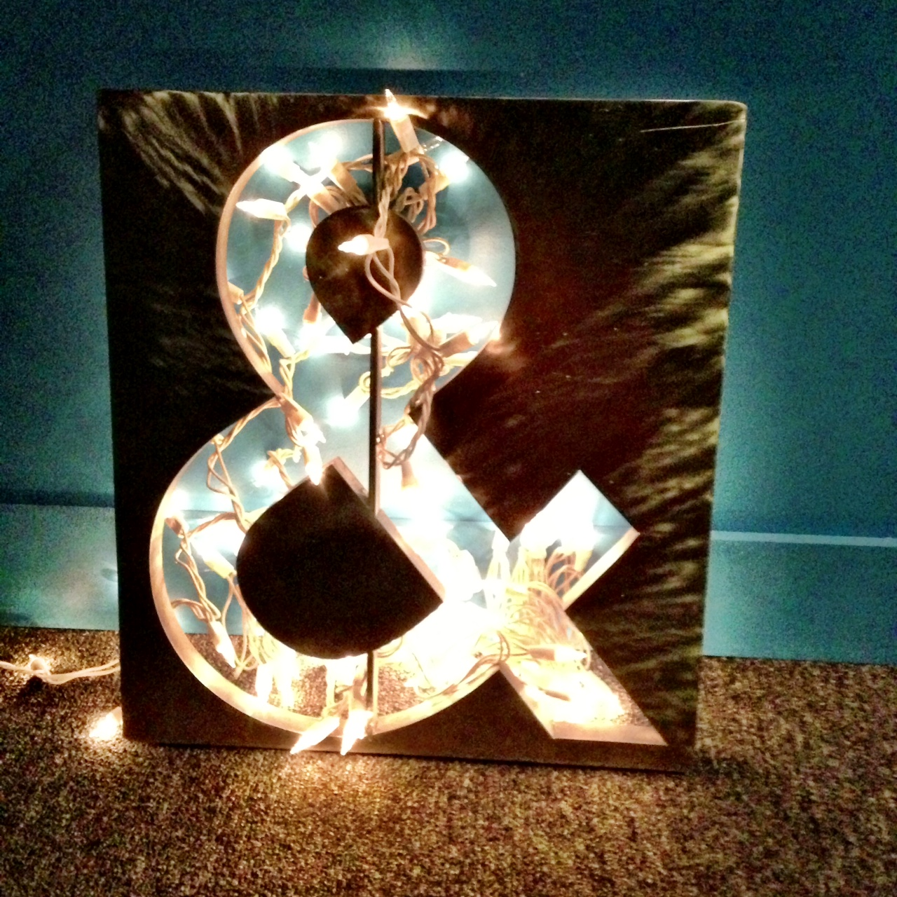 an ampersand decorated with lights